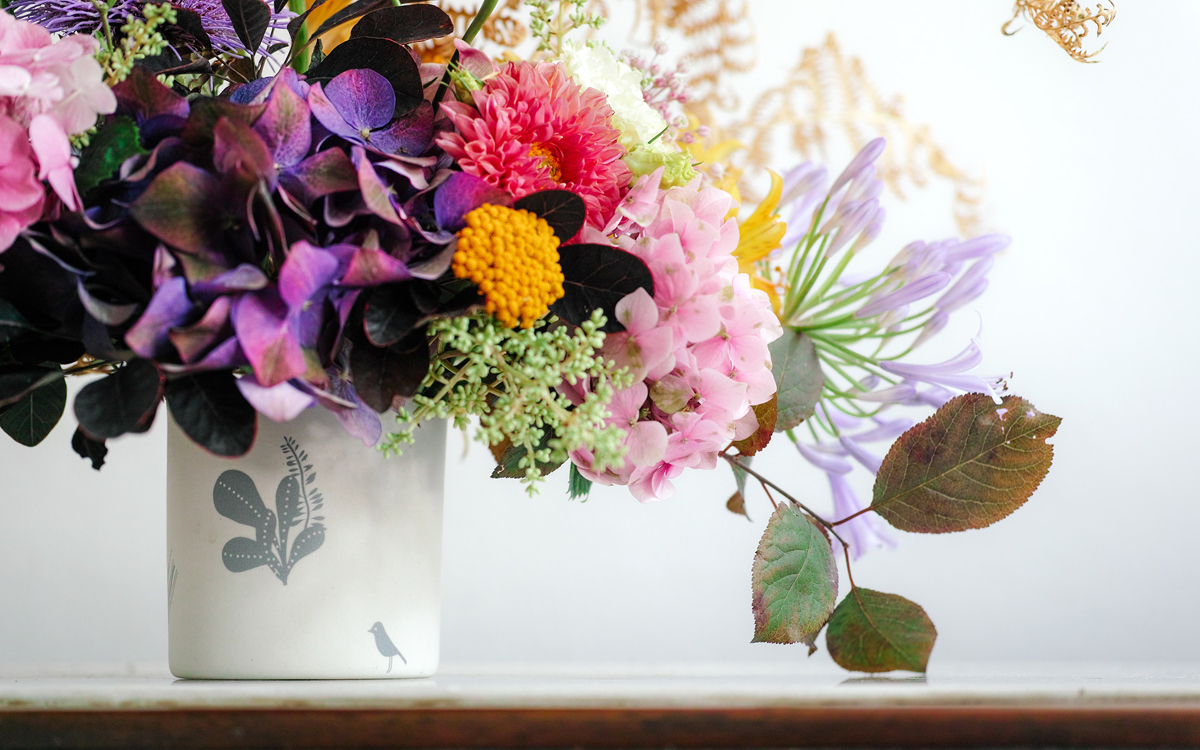Flowers on ceramic vase bird (detail)