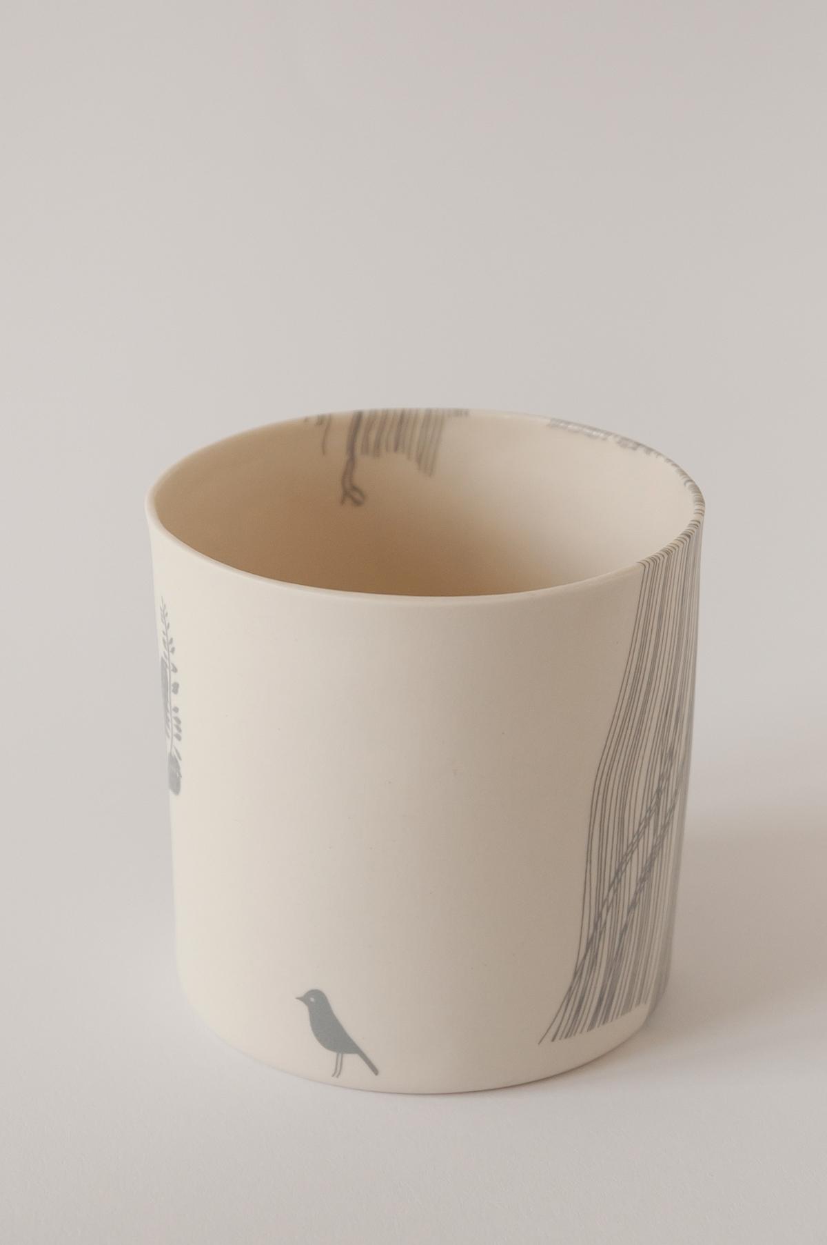 illustrated ceramic vase with bird